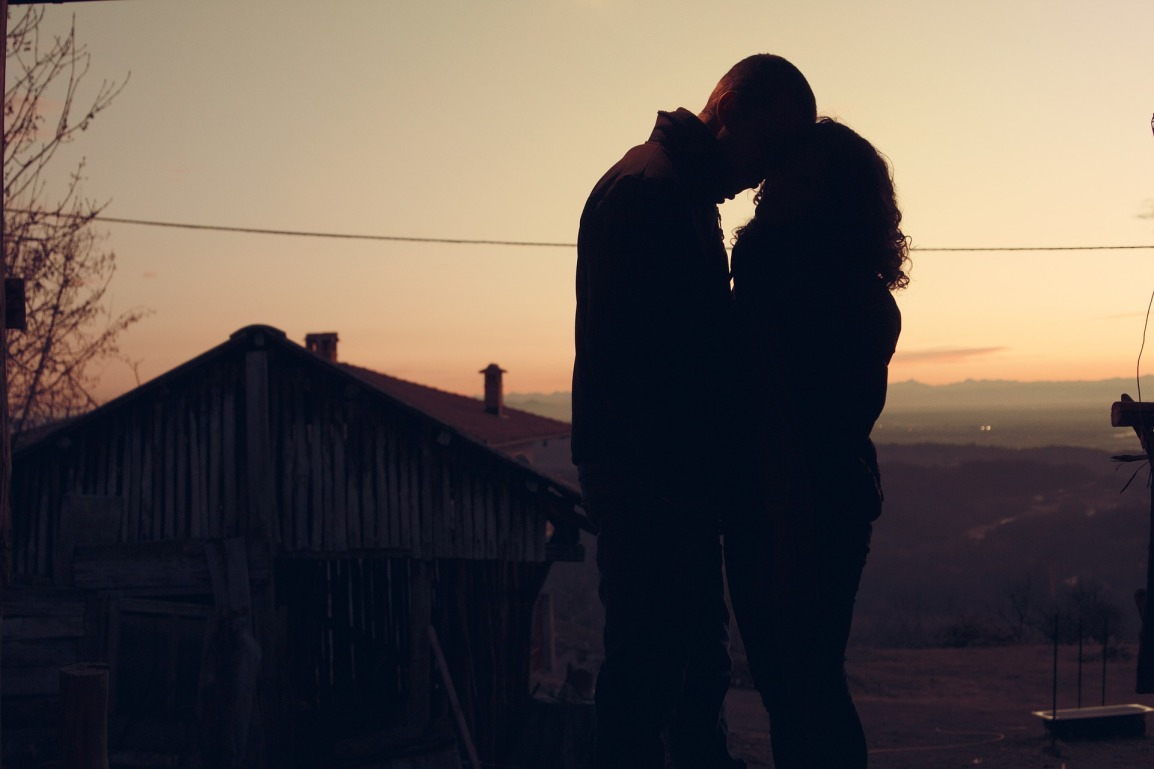 couple hugging sunset