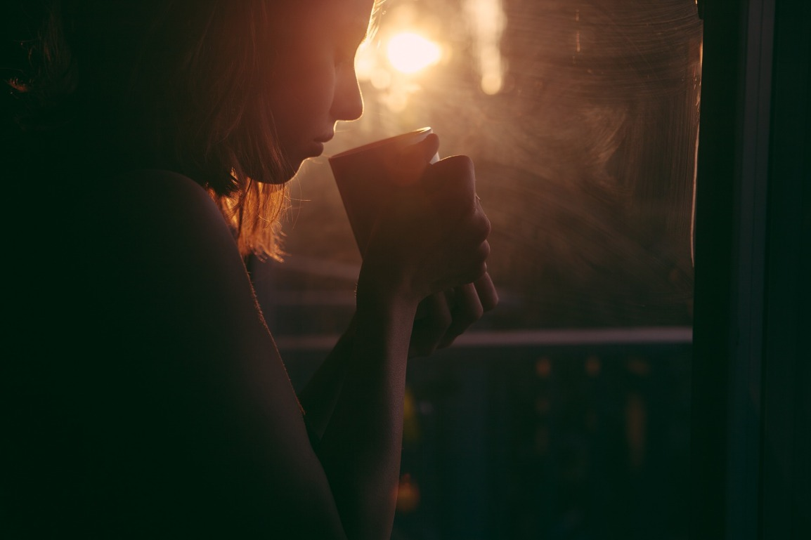 woman drinking coffee alone