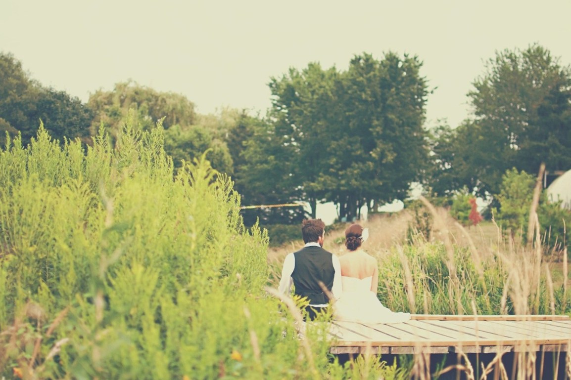 married couple sitting on dock